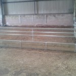 Sheep feed barrier with removable extra bar
